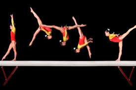 This gymnast on the balance beam is an excellent example of balance, power, coordination, agility, and flexibility.
